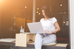Charming latin woman is connecting to wireless for browsing internet on laptop computer Royalty Free Stock Images