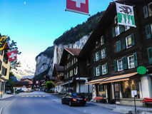 Charming Lauterbrunnen Village View at sunset with Staubbachfall and Lauterbrunnen Valley as a background Royalty Free Stock Photo