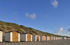 Beach Huts. Charming line of beach huts on the wonderful and unspoilt beach of Texel, West Frisian Islands, North Holland Royalty Free Stock Photos