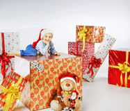 Charming little boy among the gifts Stock Image