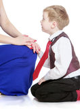 Charming little boy looks at his mother's arms Royalty Free Stock Photo