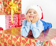 Charming little boy lying on present Royalty Free Stock Photo