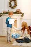 Charming little boy showing his mother new masterpiece Stock Photo