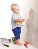 Charming little boy standing holding yellow pencil to draw isolated. Royalty Free Stock Photos