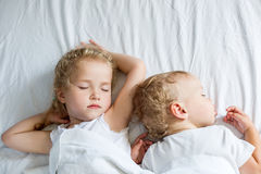 Charming little brother and sister. Asleep  on white background Royalty Free Stock Photos