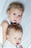 Charming little brother and sister asleep Stock Image
