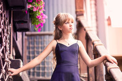 Charming little girl in a beautiful dress outdoor Stock Photo