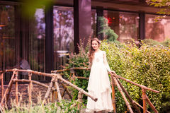 Charming little girl in a beautiful dress outdoor Royalty Free Stock Image