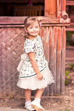 Charming little girl in a beautiful dress outdoor Stock Photos