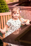 Charming little girl in a beautiful dress outdoor Royalty Free Stock Photo