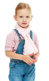 Charming little girl in blue overalls. Royalty Free Stock Images