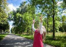 Charming little girl catching something Royalty Free Stock Photo