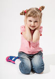 Charming little girl closing her ears Royalty Free Stock Images