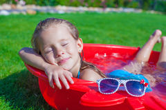 Charming little girl enjoying her vacation in the Royalty Free Stock Photos
