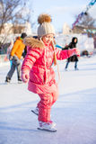 Charming little girl enjoys skating at the Royalty Free Stock Photography