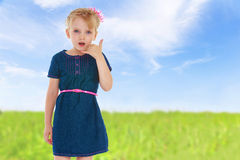 Charming little girl gesturing Royalty Free Stock Photos