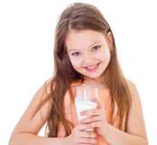 Charming little girl with a glass of milk. Royalty Free Stock Photos