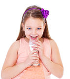 Charming little girl with a glass of milk. Royalty Free Stock Photo