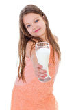 Charming little girl with a glass of milk. Stock Photo