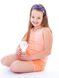 Charming little girl with a glass of milk. Stock Image