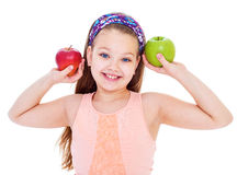 Charming little girl with green apple. Royalty Free Stock Photos