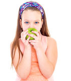 Charming little girl with green apple. Stock Photo