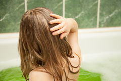 Charming little girl has a bath Royalty Free Stock Images