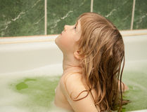 Charming little girl has a bath Stock Photos