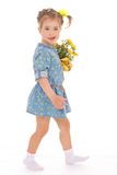 Charming little girl holding a flower bouquet. Stock Photography