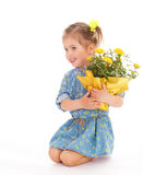 Charming little girl holding a flower bouquet. Royalty Free Stock Photos