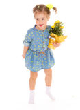 Charming little girl holding a flower bouquet. Royalty Free Stock Images