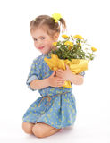 Charming little girl holding a flower bouquet. Royalty Free Stock Photo