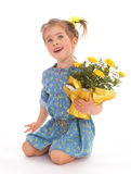 Charming little girl holding a flower bouquet. Stock Image