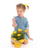 Charming little girl holding a flower bouquet. Royalty Free Stock Photography