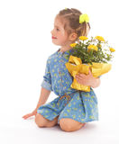 Charming little girl holding a flower bouquet. Royalty Free Stock Image