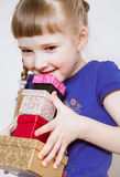 Charming little girl holding several boxes Stock Image