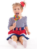 Charming little girl with a lollipop. Royalty Free Stock Image