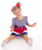 Charming little girl with a lollipop. Stock Images