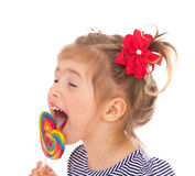 Charming little girl with a lollipop. Stock Photo