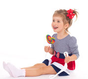 Charming little girl with a lollipop. Royalty Free Stock Photography