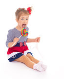 Charming little girl with a lollipop. Stock Photos