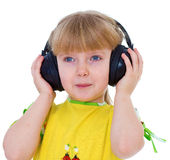 Charming little girl loves to listen to music Royalty Free Stock Photo