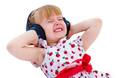 Charming little girl loves to listen to music Royalty Free Stock Photos