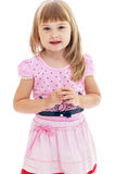 Charming little girl in a pink dress. Royalty Free Stock Images
