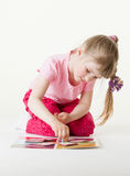 Charming little girl playing on the floor Stock Images