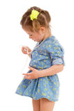 Charming little girl playing and having fun. Royalty Free Stock Images