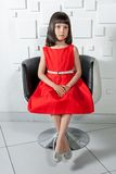 Charming little girl in a red dress Stock Photo