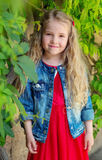 Charming little girl in a red dress Stock Photography
