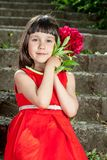 Charming little girl in a red dress Royalty Free Stock Photography