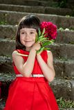 Charming little girl in a red dress Royalty Free Stock Photos